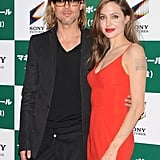 Brad Pitt wrapped his arm around Angelina Jolie.