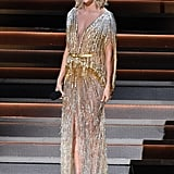 Carrie wore a beaded, ombre caftan dress by Labourjoisie.