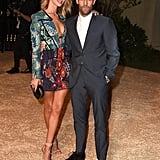 "Attending Burberry's ""London in Los Angeles"" event in LA in a plunging Burberry mini with her boyfriend, Jason Statham."
