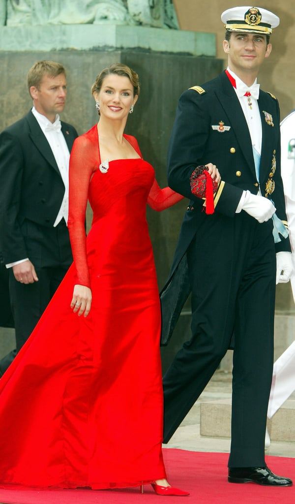She wore an elegant red dress when the couple attended the wedding of Danish Crown Prince Frederik and Mary Donaldson in May 2004.