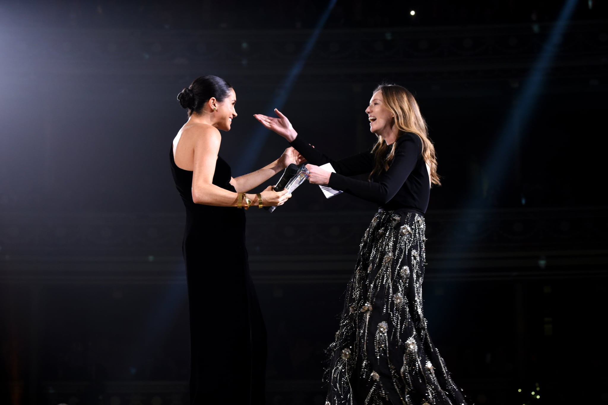 LONDON, ENGLAND - DECEMBER 10:  Meghan, Duchess of Sussex presents the award for British Designer of the Year Womenswear Award to Clare Waight Keller for Givenchy during The Fashion Awards 2018 In Partnership With Swarovski at Royal Albert Hall on December 10, 2018 in London, England.  (Photo by Joe Maher/BFC/Getty Images)