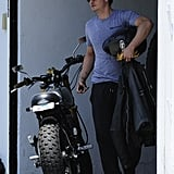 Orlando Bloom looked cool as he carried his helmet and leather jacket in West Hollywood.
