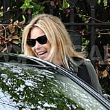Kate Moss laughed in London.