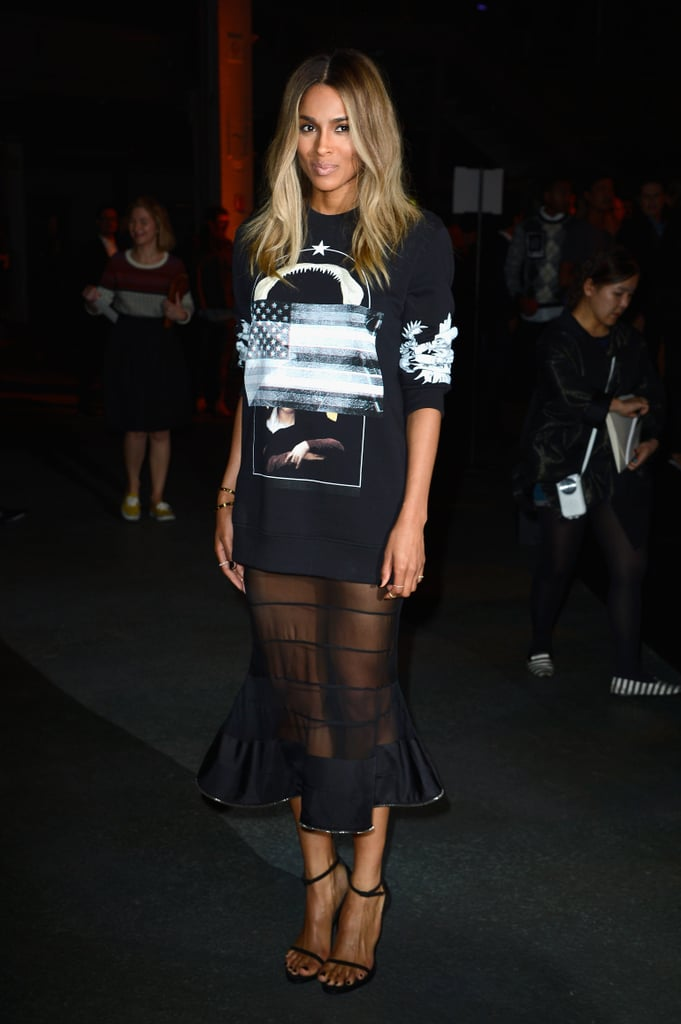 Ciara paired a printed sweater with a sheer midi skirt and ankle-strap sandals at Givenchy.