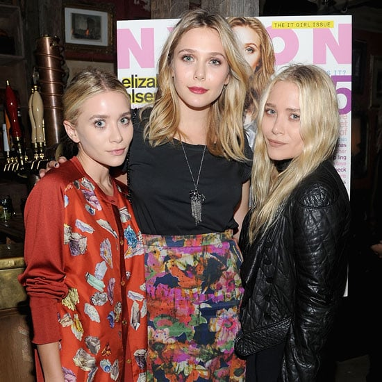 Sisters Ashley, Mary-Kate, and Elizabeth Olsen posed in front of Elizabeth's Nylon cover.