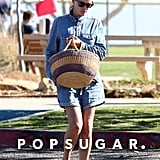 Julia styled her long-sleeved chambray romper with her basket tote and eye-catching sandals in Malibu in October 2016.