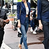Channel Alessandra Ambrosio and add a Spring touch to a blazer by pairing it with sandals and a crop top.