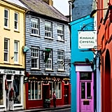 "What made me instantly captivated by the town of Kinsale was its beautiful setting. Perched high atop a sparkling waterfront, it was practically begging to be explored. Just when I thought it couldn't get any cuter, I stepped foot onto the narrow winding streets lined with brightly painted shops and cafes and fell even more in love.   Another tip for discovering the best of Kinsale? Make sure to bring along your appetite. Often referred to as ""The Gourmet Capital of Ireland,"" this bustling village is packed to the brim with delicious pubs and restaurants."