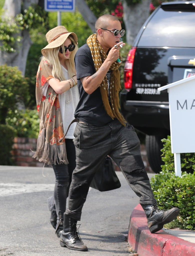 Ashlee Simpson covered up with a hat.