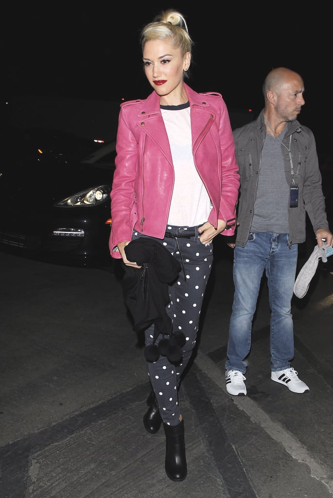 Gwen Stefani showed her cool factor in Paige Denim polka-dot jeans, which she paired with a white ringer tee and hot-pink leather jacket. Can she get any more stylish?