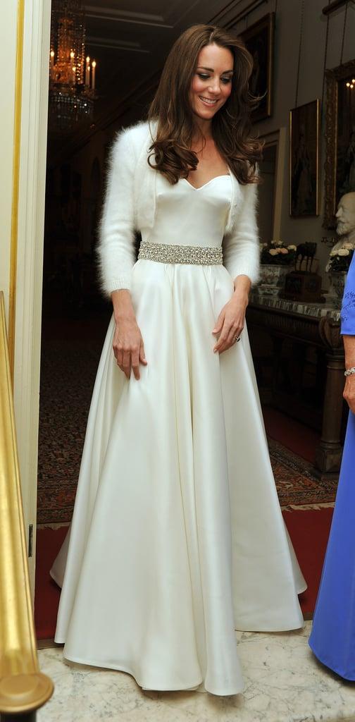 Wearing custom Alexander McQueen on her wedding day in April 2011.