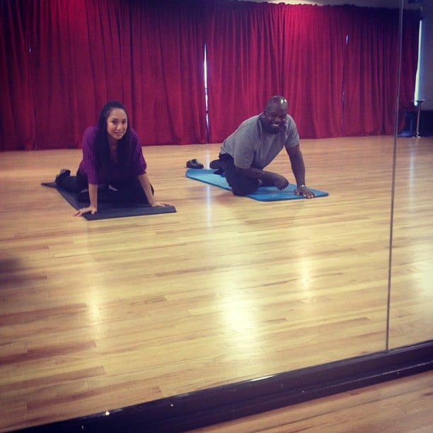 DWTS partners Cheryl Burke and Emmitt Smith stretched out their sore muscles.  Source: Instagram user cherylburke