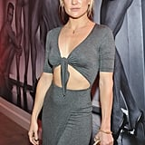Oct. 23: She showed off her stomach at a party for footwear designer Brian Atwood . . .