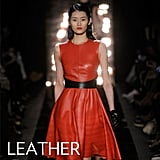 Why we love them: We love that leather has become a mainstay in our closets, taking over our bottoms first, now our dresses. Fall's iterations are a mix of both cool-girl minis and more feminine silhouettes. How to wear them: Channel a bold take on the trend in a red-hued leather dress and black pumps for a night out (red lipstick recommended), or go for a cozier, street-styled version with sheer black tights, chunky ankle boots, and a cashmere cardigan to contrast the slick leather texture. In this photo: Monique Lhuillier Fall 2012