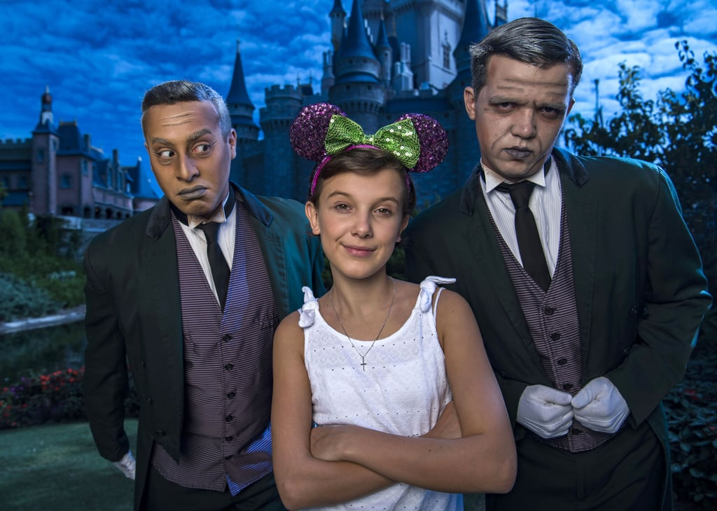 In October 2016, Millie Brown posed with two grave diggers from the Haunted Mansion ride at Magic Kingdom.