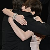 Anne Hathaway hugged Hugh Jackman at the Oscars 2013.