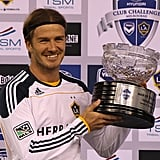 David Beckham held up the LA Galaxy trophy during a press conference in Melbourne.