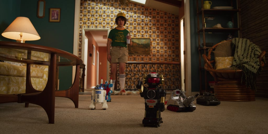 """He's welcomed home from Summer camp by a bunch of """"robots,"""" FYI."""