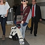 Even Her Cozy Airport Style Gets Some Extra Oomph
