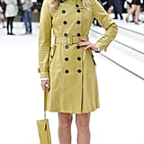 A double-breasted yellow coat and ankle boots were an early Burberry look for Suki at the brand's show in September 2012.