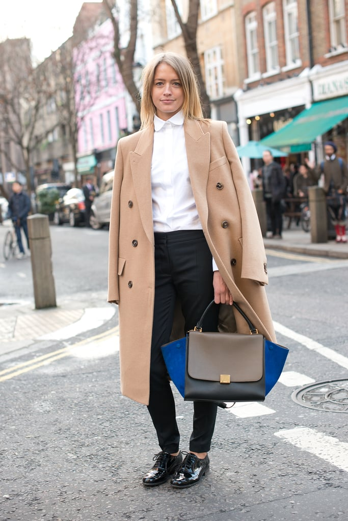 The chicest of duos: a classic camel coat and a colorblocked Céline bag.