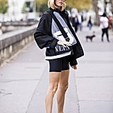 Biker shorts and a windbreaker look decidedly cooler with a fresh pair of ankle boots.