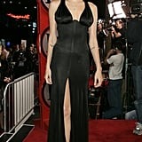 In a black silk gown at the 2004 premiere of Alexander.