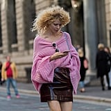 Tuck a powder pink sweater into a dark burgundy skirt to play with Fall's most popular tones.