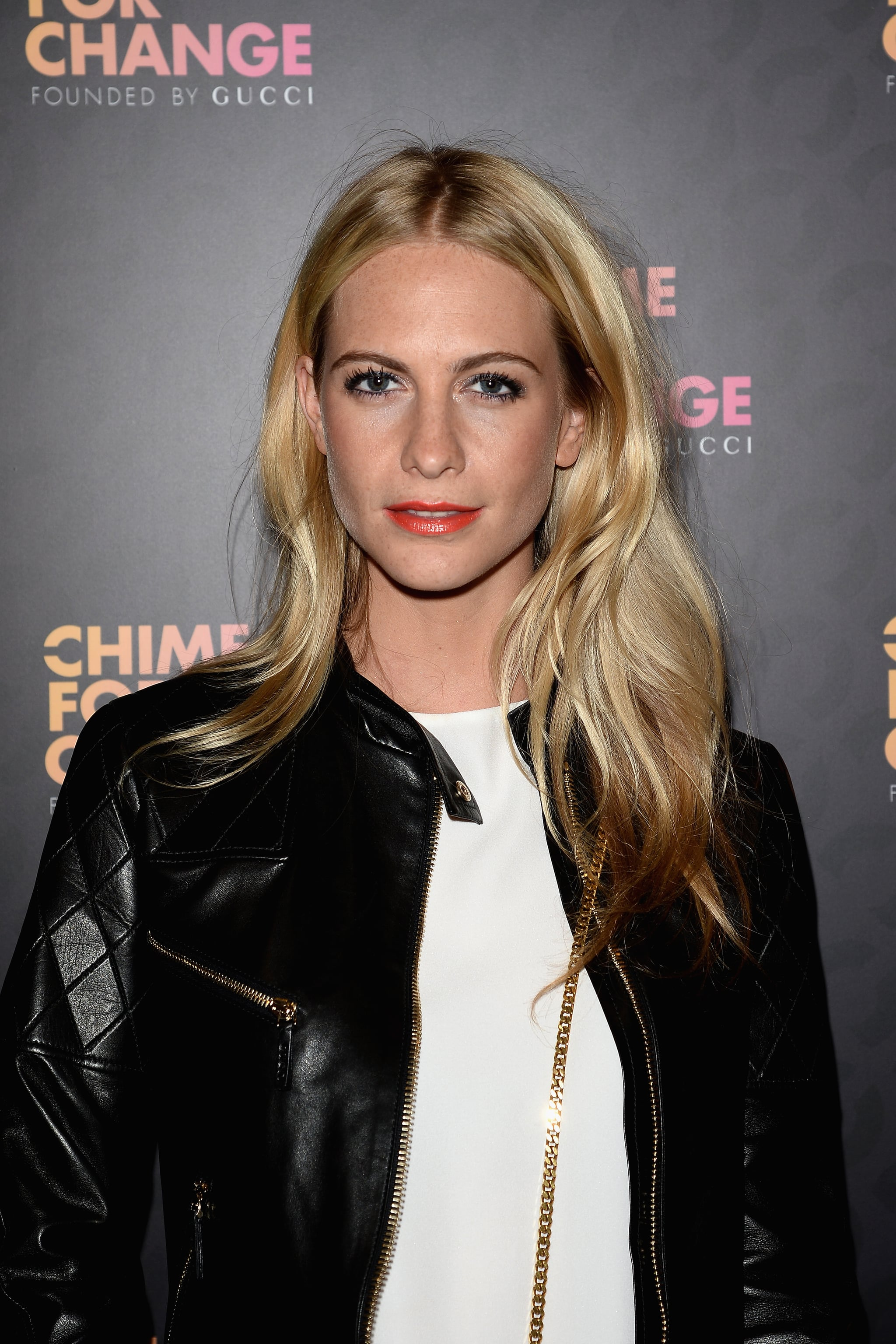 Poppy Delevingne wore her standard mussed waves and an electric orange lip color.
