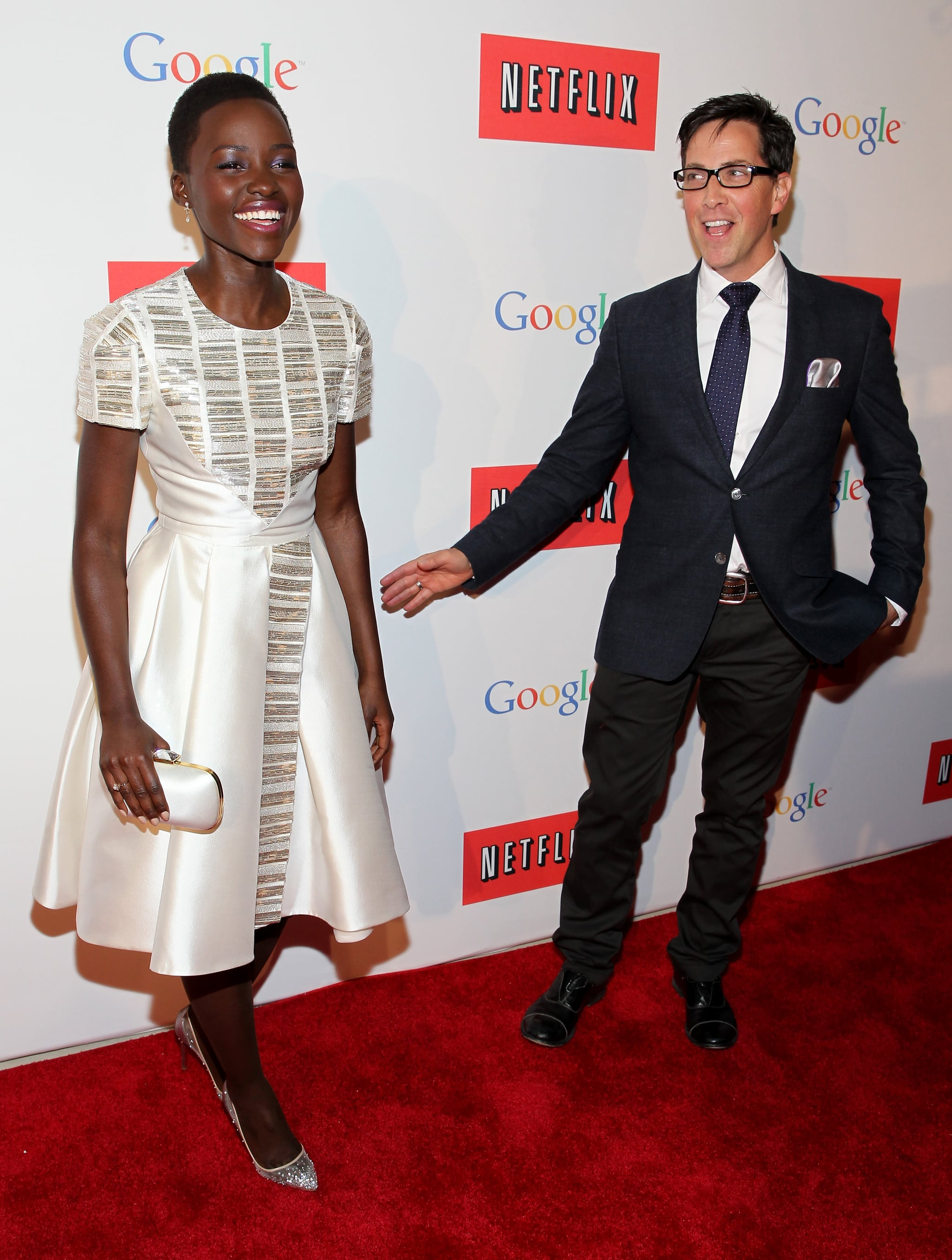 Lupita Nyong'o shared a red carpet moment with Scandal actor Dan Bucatinsky at Google and Netflix's bash on Friday.
