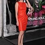 Charlize wore a hot red dress to her Young Adult premiere.