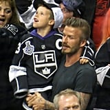 Cruz Beckham was in his dad, David Beckham's, arms for the LA Kings Stanley Cup final game in LA.