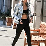 Bella Hadid stayed warm in her crop top with a metallic puffer jacket from Tommy Jeans.