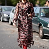 Thassia Naves pulled an easy styling hack by matching her boots to one of the colors in her floral dress.