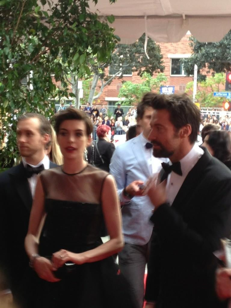Anne Hathaway, in Giambattista Valli Haute Couture, rushed in alongside her Les Misérables costar Hugh Jackman. Source: Twitter user LOrealParisUSA
