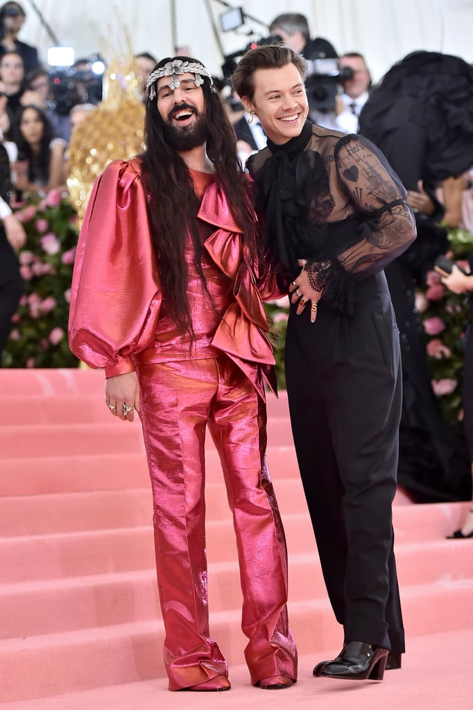 "Harry Styles made his Met Gala debut on Monday in NYC, as a cohost no less! The 25-year-old singer walked the red carpet at The Metropolitan Museum of Art alongside Alessandro Michele, the creative director of Gucci and another cohost for the ""Camp: Notes on Fashion""-themed event. Harry wore an all-black Gucci outfit, with a sheer ruffle blouse, a single pearl earring, multicoloured panted nails, and the highest high-waisted trousers we've ever seen.  Harry's kept a relatively low-profile since wrapping up his tour in 2018, although he did make a brief appearance back in March to sing with Stevie Nicks at the Rock & Roll Hall of Fame. Hopefully his fashionable step back into the limelight means more red carpet appearances in the near future. Ahead, see more snaps from Harry's glam night out at his first Met Gala."