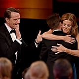 Aaron Paul got a hug from his Breaking Bad costar Anna Gunn while Bryan Cranston cheered.