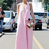 She scored extra points for matching her camera to the pastel-pink hue of her maxi dress.