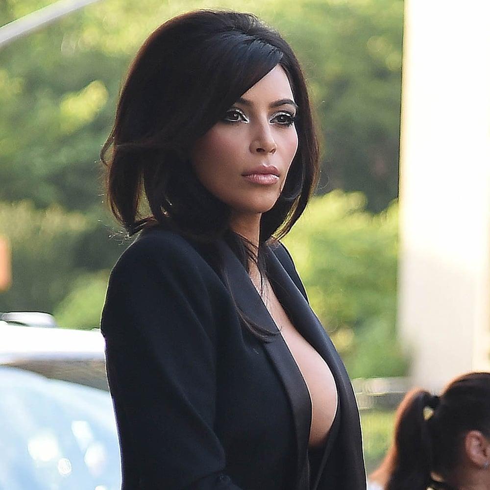 Kim-Kardashian-Cleavage-Revealing-Black-Suit.jpg