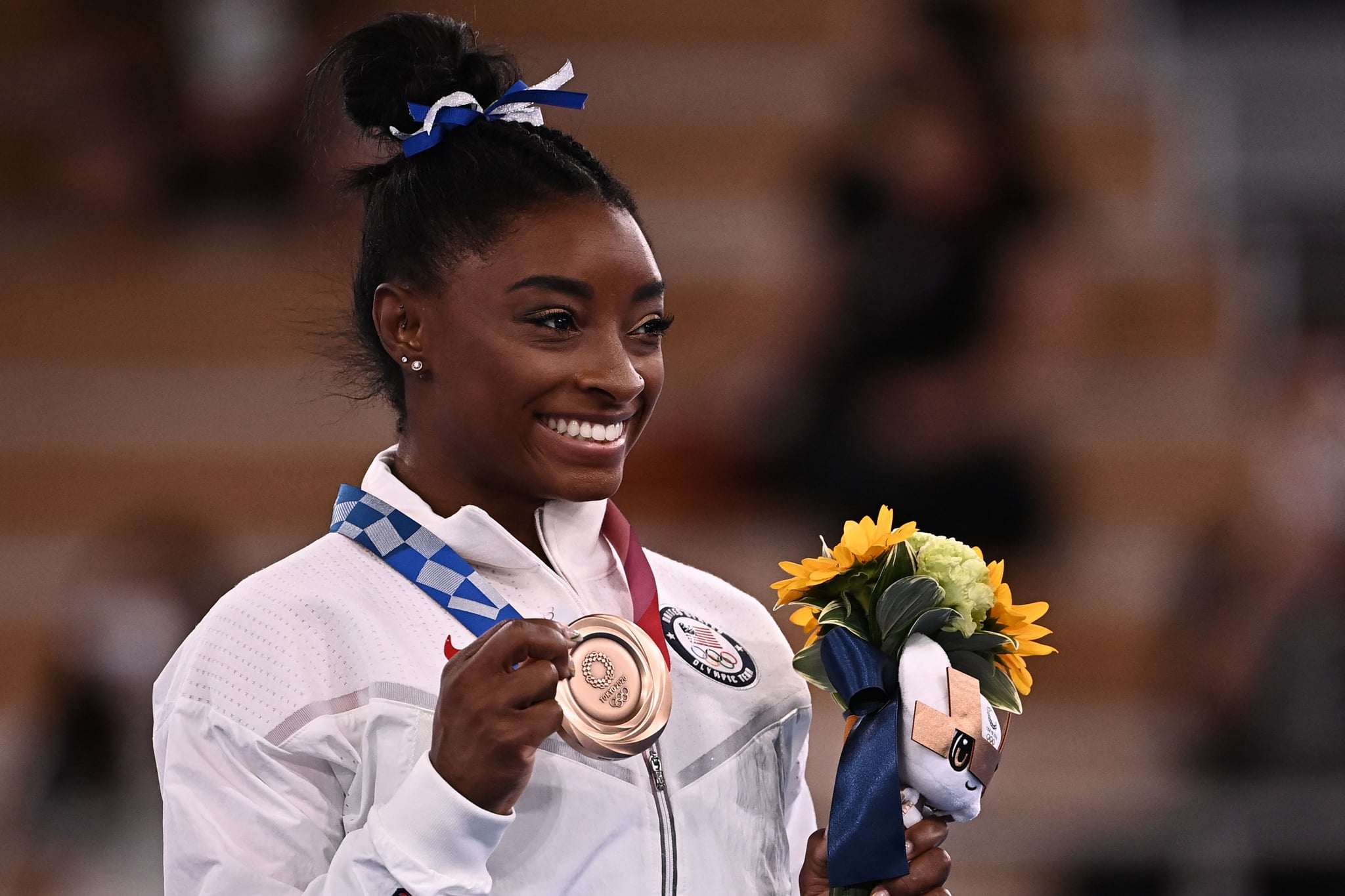 USA's Simone Biles poses with her bronze medal during the podium ceremony of the artistic gymnastics women's balance beam of the Tokyo 2020 Olympic Games at Ariake Gymnastics Centre in Tokyo on August 3, 2021. (Photo by Lionel BONAVENTURE / AFP) (Photo by LIONEL BONAVENTURE/AFP via Getty Images)