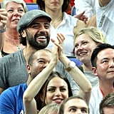 Kirsten Dunst smiled at Oscar Issac during the game.