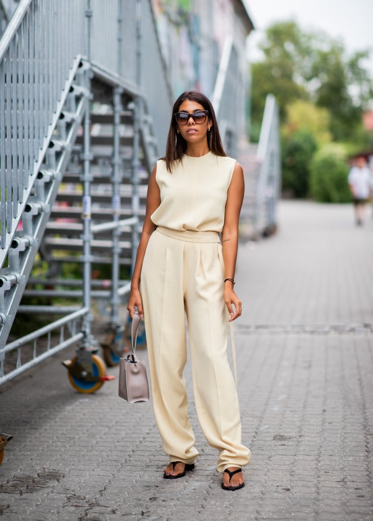 Styling a black pair with a beige jumpsuit.