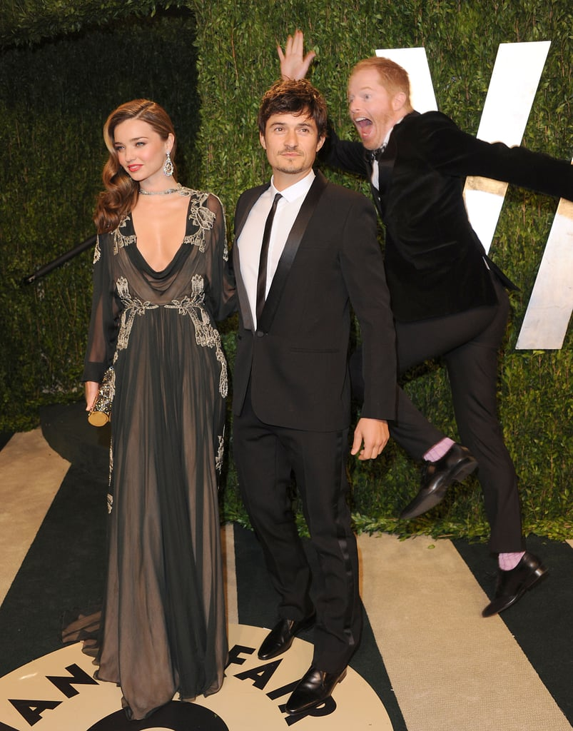 Miranda Kerr wore Valentino to accompany her husband, Orlando Bloom, to the Vanity Fair Oscar party at Sunset Tower yesterday. As they posed for photos before entering the party, they had an unexpected guest in a few shots — they got photobombed by Modern Family actor Jesse Tyler Ferguson! Miranda, Orlando and Jesse Tyler were among the many celebrities at the 2013 Vanity Fair Oscars party. Orlando and Miranda didn't attend the actual Academy Awards, but they got in on the good times at the magazine's annual legendary bash.