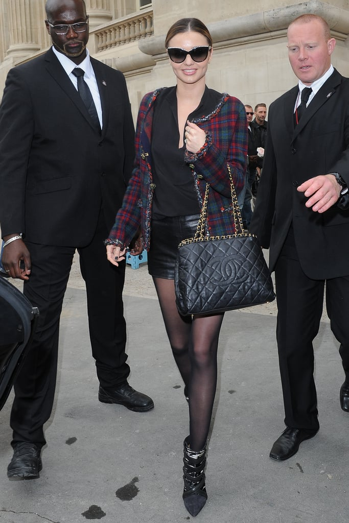 Outside the Chanel show during Paris Fashion Week, Miranda Kerr showed off a black quilted Chanel bag and a sophisticated checkered jacket.
