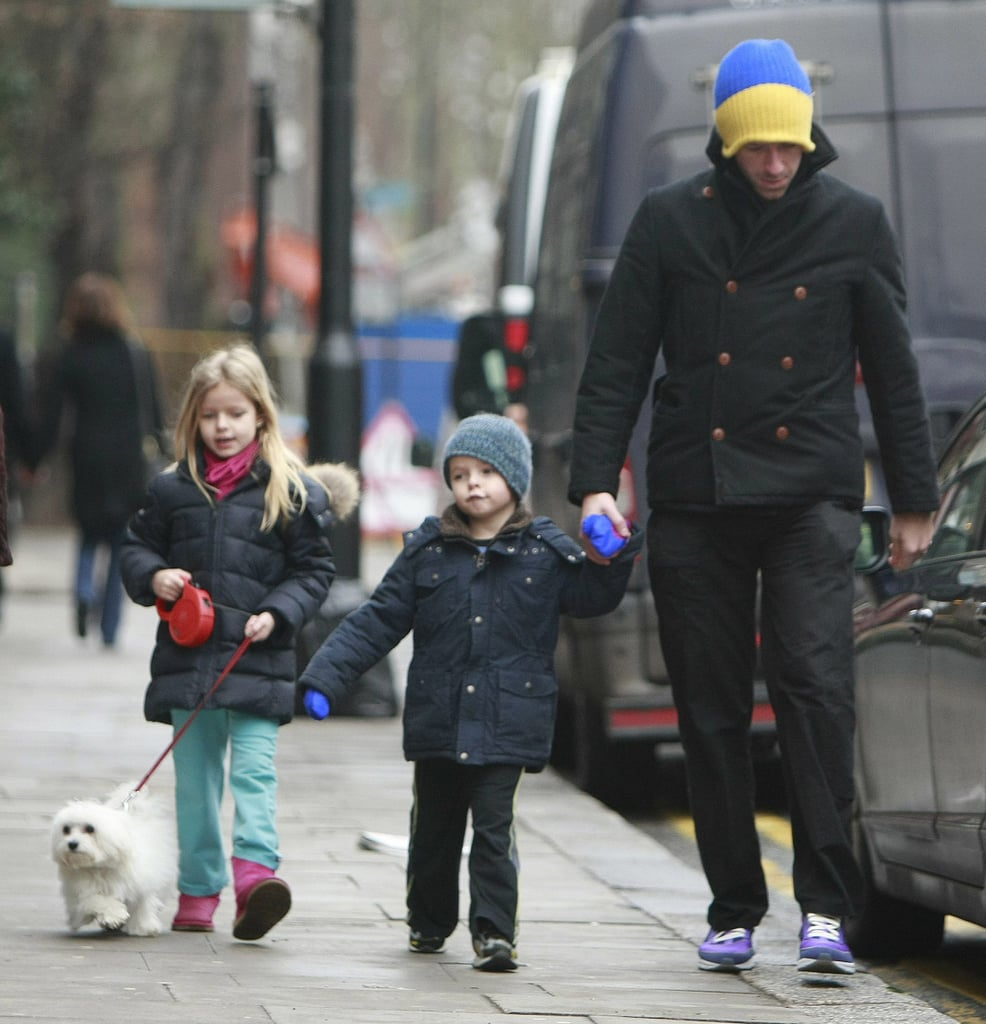 "Chris Martin took his kids Apple and Moses for a walk in London on Monday. Moses held onto dad's hand while Apple, looking every bit the Gwyneth Paltrow mini me, took charge of her cute pup's leash. Chris and Gwyneth both have busy schedules to juggle along with parenthood, including her latest trip to Switzerland. She was back in the UK this weekend to enjoy a fun night out while Chris performed at a birthday party with Coldplay. Chris's original song for the Country Strong soundtrack didn't get any Oscars love when the nominations were announced yesterday, but the movie did receive one nod for its title track, ""Coming Home,"" putting a bright spot in their rough run at the box office."