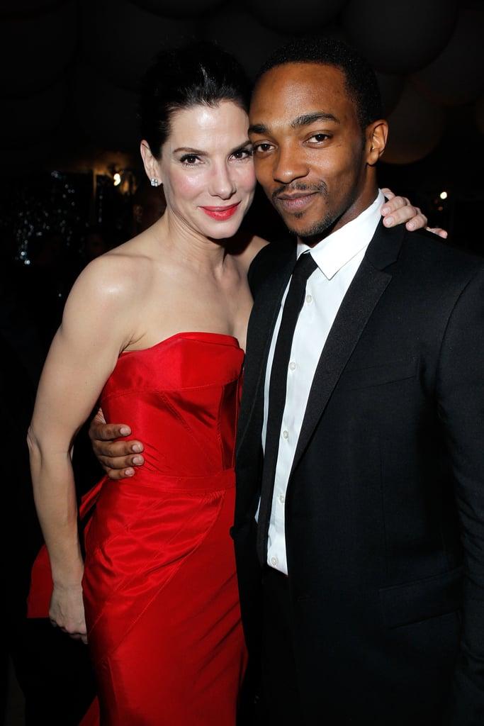 Sandra Bullock shared a hug with Anthony Mackie at a February 2011 post-Oscar bash in LA.