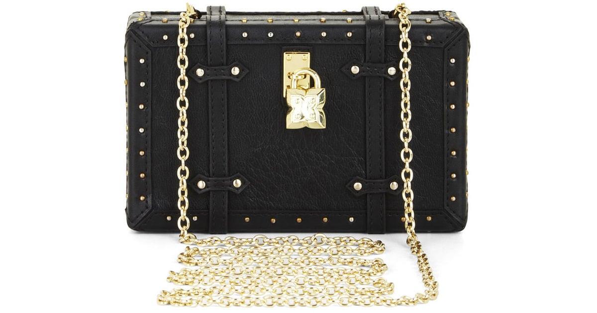 9ec20ff8edd BCBG Max Azria Studded Faux-Leather Luggage Clutch ( 188)   Fall Bag Trends  2015   POPSUGAR Fashion Photo 22