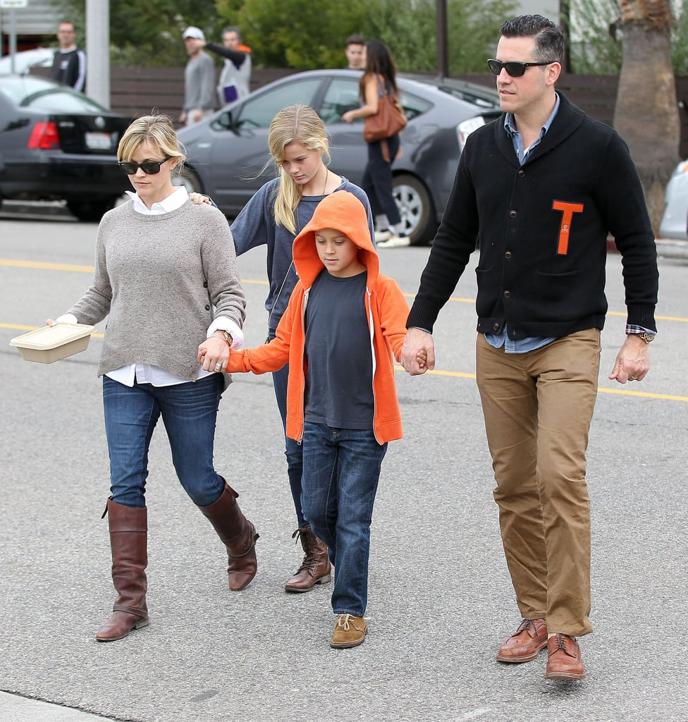 Reese Witherspoon and her husband, Jim Toth, took their oldest kids, Ava and Deacon, out for breakfast at Axe in LA yesterday morning. The newest addition to the Witherspoon-Toth family, baby Tennessee, wasn't able to attend. However, proud dad Jim showed his affection for the little one by wearing a letter sweater from Tennessee, Reese's home state. Jim also seemed to be rooting for the football players of the University of Tennessee, who took on, but ultimately lost to, Texas yesterday.  Reese's day with Jim, Ava, and Deacon came after she made time for a girlfriend earlier in the weekend. Reese and pal Mindy Kaling had lunch together Saturday.