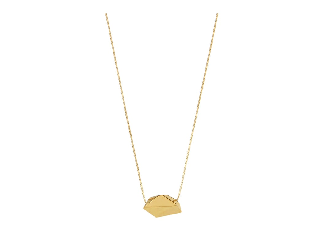The gold nugget pendant necklace ($95) by Michael Kors has a cool, organic-chic style that'll go with everything in her closet.