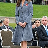 Kate wrapped up her tour of Australia in an indigo and white Michael Kors coat.